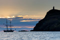An old fashioned tall ship at sunset in port erin beside bradda head and milners tower landmark the isle of man taken just before Stock Images
