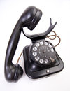 Old fashioned telephone on the white backing closeup isolated Royalty Free Stock Image