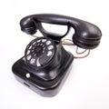 Old fashioned telephone on the white backing under strange angel isolated Royalty Free Stock Photography