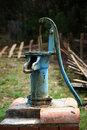 Old fashioned water pump blue in a farm garden Stock Photo