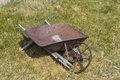 Old fashioned wheelbarrow an and broken Royalty Free Stock Images