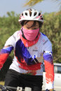 Old female cycling enthusiast wearing masks in amoy city china Royalty Free Stock Photography