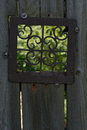 Old Fence with Metal Window Royalty Free Stock Photo