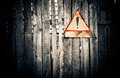 Old fence wooden with warning sign Royalty Free Stock Photo