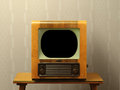 Old fifties television nineteen and table wallpaper not in focus Royalty Free Stock Photos