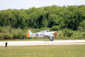 Old fighter plane landing ww at d similar to the at trainers built in dallas tx also known as the texan the terrible texan the j Stock Photos