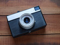 Old film camera an russian on a wooden table Royalty Free Stock Photo