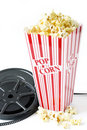 Old film reel with popcorn Royalty Free Stock Photography
