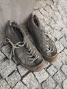Old filthy shoes Royalty Free Stock Photo