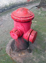 Old fire hydrant on a sidewalk Stock Image