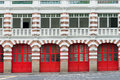 Old fire station with red gates Royalty Free Stock Image