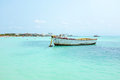 Old fisher s boat at palm beach in aruba in the carribean sea Royalty Free Stock Photos