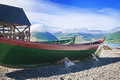 Old fishing boat ashore in island Royalty Free Stock Photos