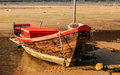 Old fishing boat on the beach Royalty Free Stock Image