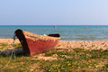 Old fishing boat on the beach Stock Photo