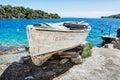 Old fishing boat with cracked white paint, Solta island, Croatia Royalty Free Stock Photo