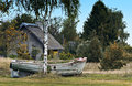 Old fishing boat on the grass latvia near fishermen village in county of kurzeme Royalty Free Stock Image
