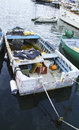 Old fishing boat in the harbour of fezzano Stock Photos
