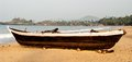 Old fishing boat on the sandy shore in goa Royalty Free Stock Photos