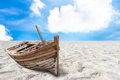 Old fishing boat stranded on a beach in sunny day illustration or general background Stock Photos