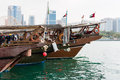 Old fishing boats in abu dhabi uae buildings skyline with on the front Stock Photos