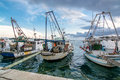 Old fishing boats in harbor anchored Royalty Free Stock Photography