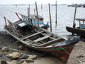Old fishing boats wooden on the beach Royalty Free Stock Photography