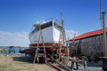 Old fishing trawler being restored in old boat yard historic and repainted on a chesapeake bay builders Royalty Free Stock Photos