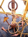 Old five pointed rusty anchor an on a boat in south india kerala waters grappling hook Stock Photo