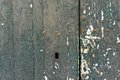 Old flaking paint on wooden door and key hole a close up of a grungy with which may be suitable as a texture or background Stock Photo