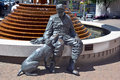 Old flyfisherman and his dog victoria bc canada june a sculpture of an trusty companion shaker by nathan scott Stock Photo