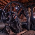 Old flywheels inside the old wooden factory Royalty Free Stock Photo