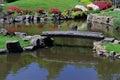 Old Footbridge across a Pond Royalty Free Stock Photo