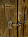 Old forged latches at the door barn Royalty Free Stock Photography
