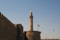 Old Fort and  tower of a nearby mosque. Dubai Royalty Free Stock Photo
