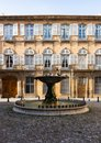 Fountain in the Courtyard with Old Three Story Building in Background Royalty Free Stock Photo