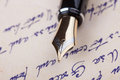 Old fountain pen and old manuscript close up Stock Image