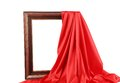 Old frame and red silk drapery isolated on a white background Stock Photography