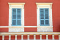 Old french blue shutter windows in red house, Nice, France. Royalty Free Stock Photo