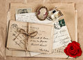Old french post cards and rose flower nostalgic accessories vintage sentimental background valentine s day concept Stock Image