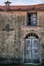 Old front door of an abandonment farmhouse in corsica france Royalty Free Stock Photos