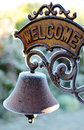 Old frozen welcome sign beautiful with bell Stock Photo
