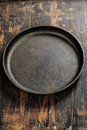 Old frying pan on wooden board Royalty Free Stock Photography