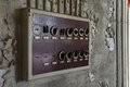 Old fuse box in an abandoned hall with switches the production Royalty Free Stock Photo