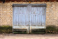 Old garage gate in the brick wall Royalty Free Stock Photography