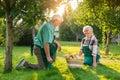 Old gardeners couple, apple basket.