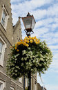 Old Gas lamp post with flowers Royalty Free Stock Photo