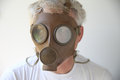 Old gas mask worn by senior man Royalty Free Stock Photography