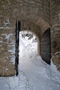 Old gate of the fortress in winter with snow Royalty Free Stock Photos