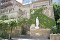 Old georgian patio in tbilisi staircase and statue of venus on the wall entwined with ivy Royalty Free Stock Photos
